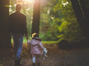 Dad walking with his daughter