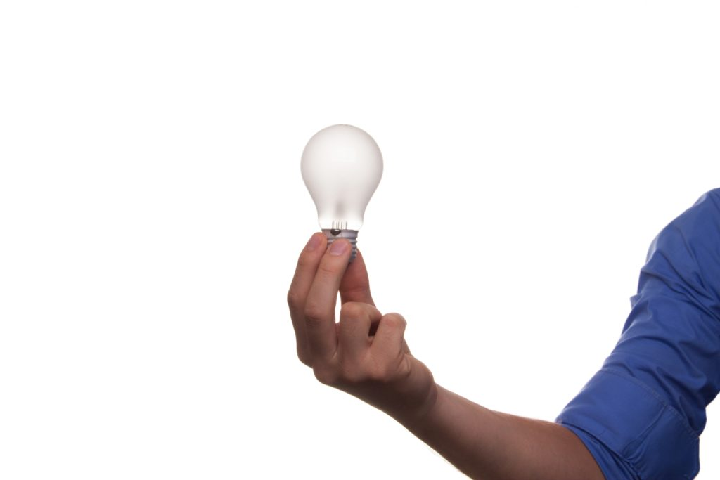 A hand holding a light bulb... Inspiration